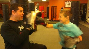 Ethan getting down to business with David at The Boxing Gym in Ballwin